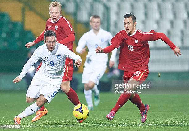 Adam Armstrong of England fights for the ball with Michael Olczyk of Poland during the Under18 International Friendly match between Poland and...