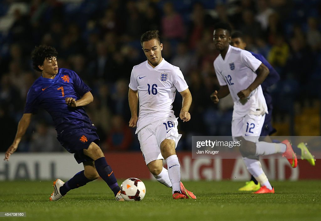 Adam Armstrong of England U18 battles with Gustavo Hamer of Netherlands U18 during the U18 International Friendly match between England U18 and Netherlands U18 at JD Stadium on September 5, 2014 in Bury, England.
