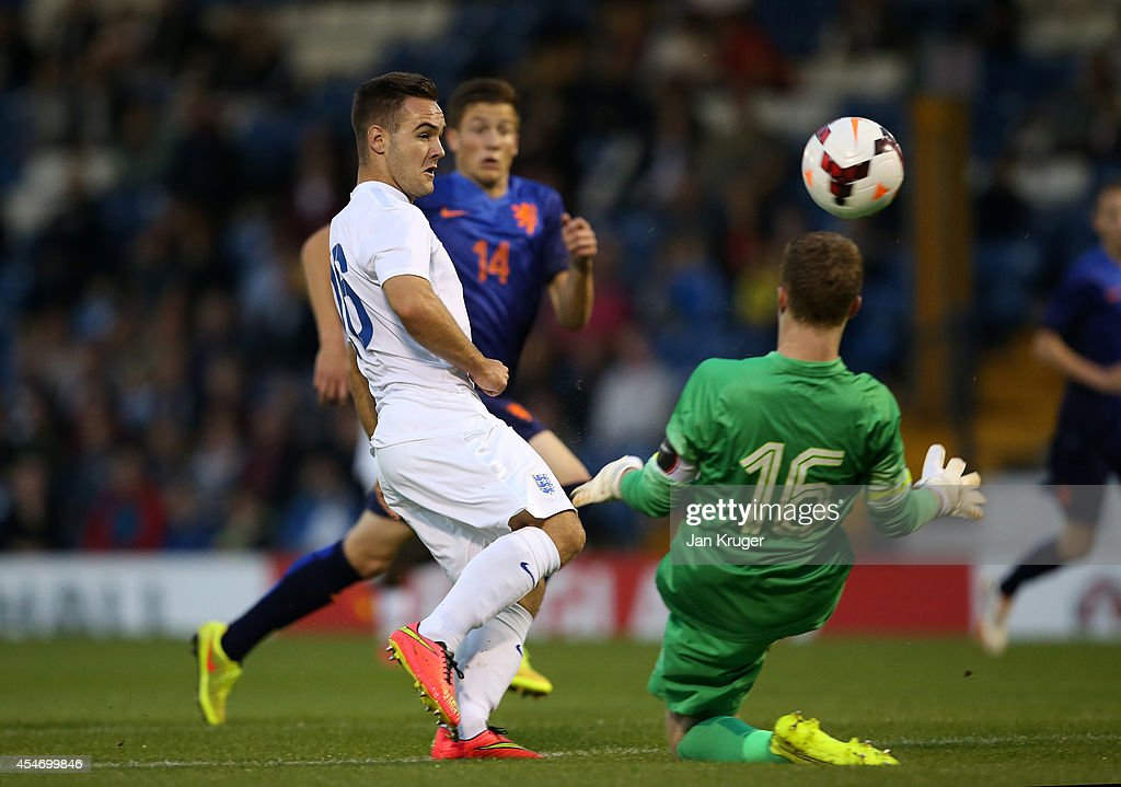 Adam Armstrong of England U18 has his shot at goal blocked by Yanick van Osch of Netherlands U18 during the U18 International Friendly match between England U18 and Netherlands U18 at JD Stadium on September 5, 2014 in Bury, England.