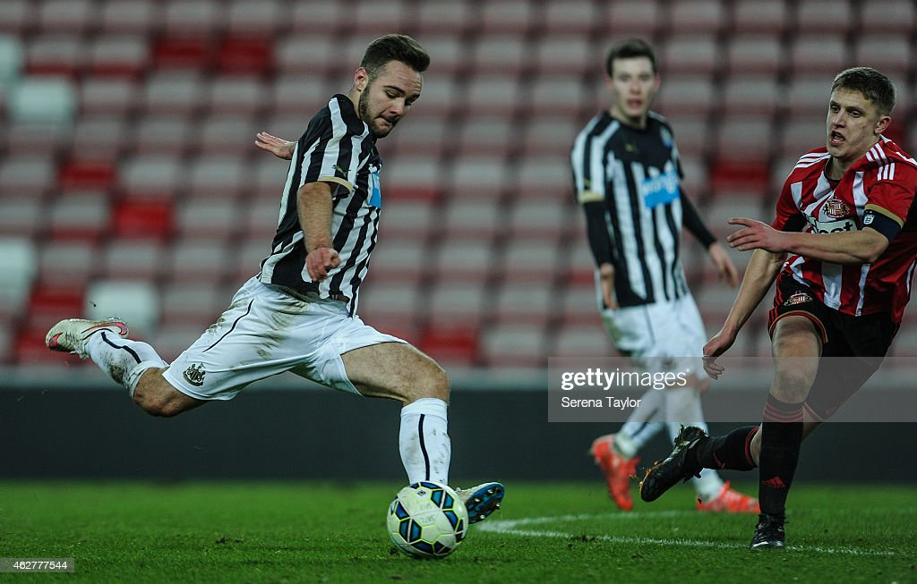 Adam Armstrong of Newcastle (L strikes the ball during the FA Youth Cup Round 5 match between Sunderland AFC and Newcastle United at The Stadium of Light on February 04, 2015, in Sunderland, England.