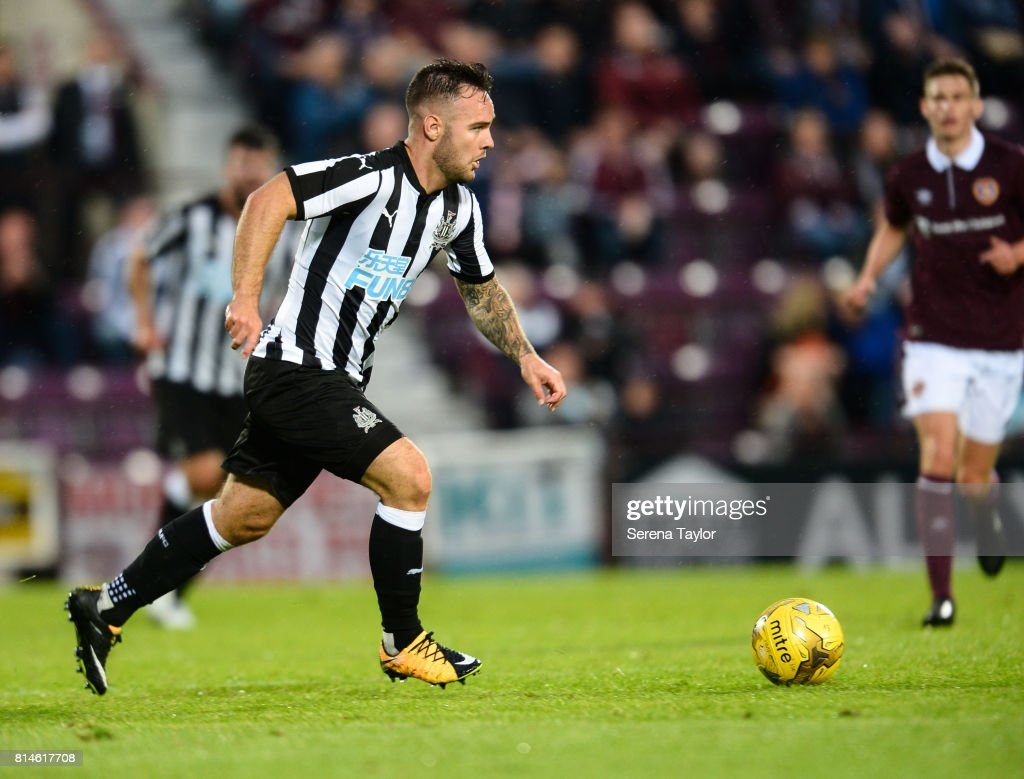 Adam Armstrong of Newcastle (32) runs with the ball during the Pre-Season Friendly between Heart of Midlothian and Newcastle United at the Tynecastle Stadium on July 14, 2017, in Edinburgh, Scotland.