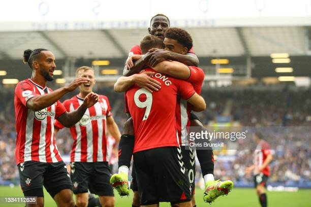 Adam Armstrong of Southampton celebrates with Che Adams and teammates after scoring their side's first goal during the Premier League match between...