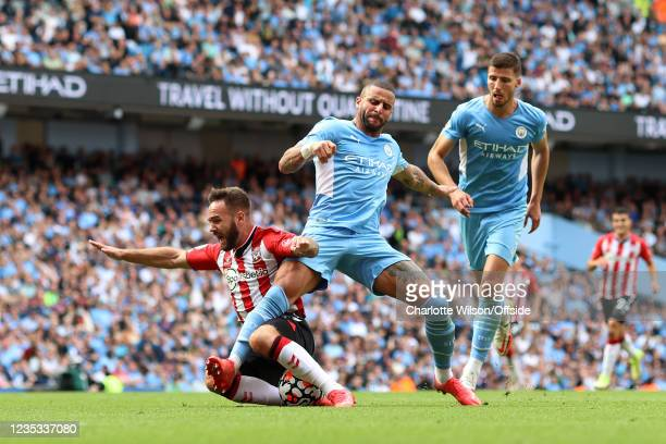 Adam Armstrong of Southampton is fouled by Kyle Walker of Man City in the box, but the penalty decision is later ruled void by VAR during the Premier...