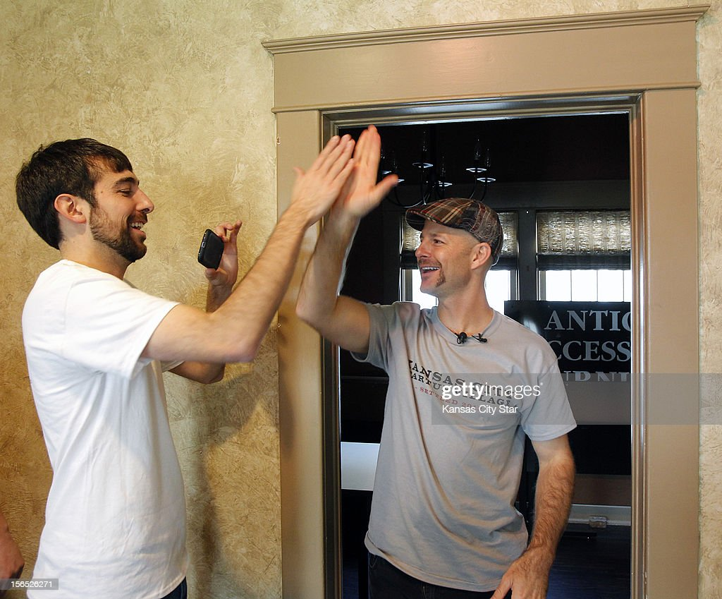 Adam Arredondo (left), CEO, and Matthew Marcus, CTO, of Local Ruckus, a Hanover Heights fiberhood in Kansas City, Kansas, high five near the completion of the Google Fiber installation process, November 13, 2012.