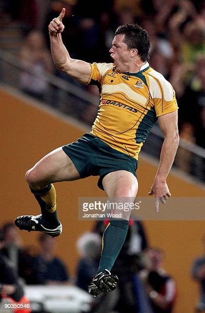 Adam Ashely Cooper of the Wallabies celebrates after scoring a try during the 2009 Tri Nations series match between the Australian Wallabies and the...