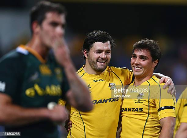 Adam Ashley-Cooper and Nick Phibbs of the Wallabies embrace as the Wallabies celebrate victory during Rugby Championship match between the Australian...