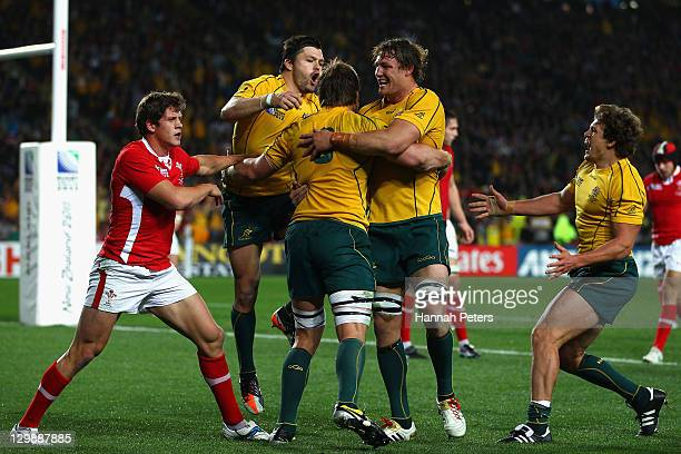 Adam AshleyCooper and Scott Higginbotham of the Wallabies celebrate with try scorer Ben McCalman of the Wallabies during the 2011 IRB Rugby World Cup...