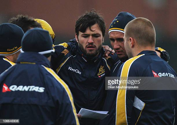 Adam AshleyCooper listens to instructions during an Australian Wallabies training session at Latymer Upper School on November 9 2010 in London England