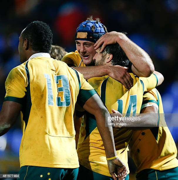 Adam AshleyCooper of Australia and teammates celebrate their team's last try during a match between Australia and Argentina as part of The Rugby...