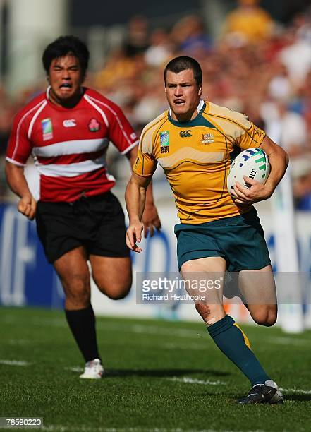 Adam AshleyCooper of Australia breaks through the defence to score a try during the match three of the Rugby World Cup 2007 between Australia and...