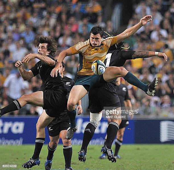 Adam Ashley-Cooper of Australia competes for the ball with New Zealand's Conrad Smith during their Bledisloe Cup rugby union match at Hong Kong...