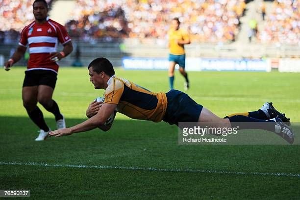 Adam AshleyCooper of Australia crosses the line to score a try during the match three of the Rugby World Cup 2007 between Australia and Japan at the...