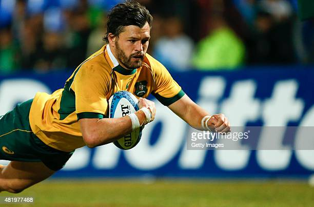 Adam AshleyCooper of Australia dives for a try during a match between Australia and Argentina as part of The Rugby Championship 2015 at Estadio...