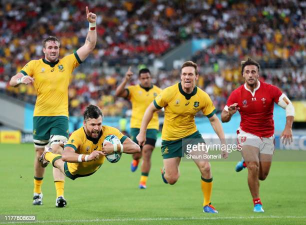 Adam AshleyCooper of Australia goes over to score his team's first try during the Rugby World Cup 2019 Group D game between Australia and Wales at...