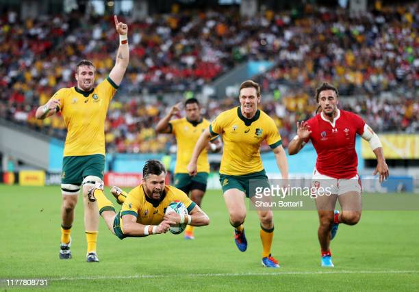 Adam Ashley-Cooper of Australia goes over to score his team's first try during the Rugby World Cup 2019 Group D game between Australia and Wales at...