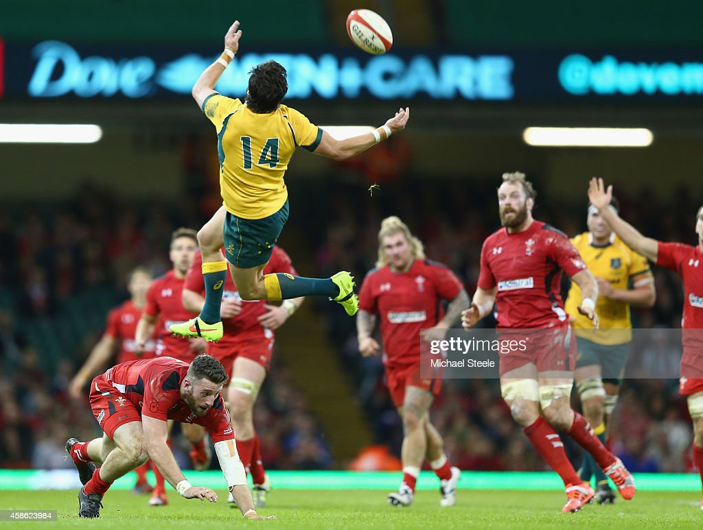 Adam Ashley-Cooper of Australia is airborne after a challenge from Alex Cuthbert (L) of Wales during the International match between Wales and Australia at the Millennium Stadium on November 8, 2014 in Cardiff, Wales.