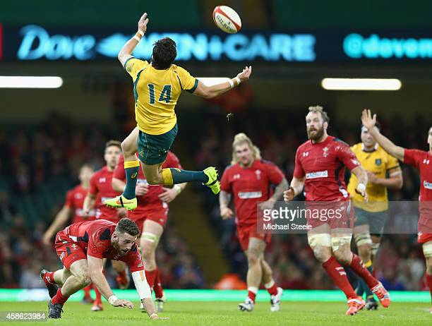 Adam Ashley-Cooper of Australia is airborne after a challenge from Alex Cuthbert of Wales during the International match between Wales and Australia...