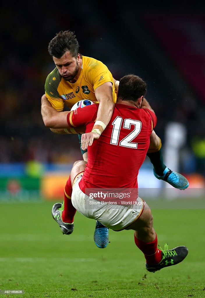 Adam Ashley-Cooper of Australia is tackled by Jamie Roberts of Wales during the 2015 Rugby World Cup Pool A match between Australia and Wales at Twickenham Stadium on October 10, 2015 in London, United Kingdom.