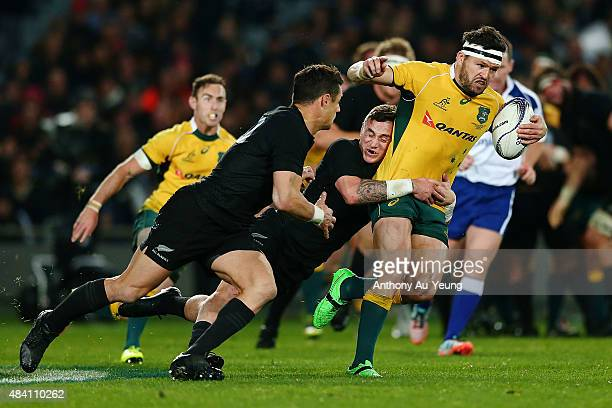 Adam AshleyCooper of Australia makes a half break against TJ Perenara of New Zealand during The Rugby Championship Bledisloe Cup match between the...