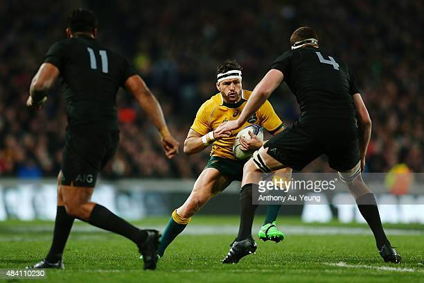 Adam AshleyCooper of Australia makes a run against Brodie Retallick of New Zealand during The Rugby Championship Bledisloe Cup match between the New...