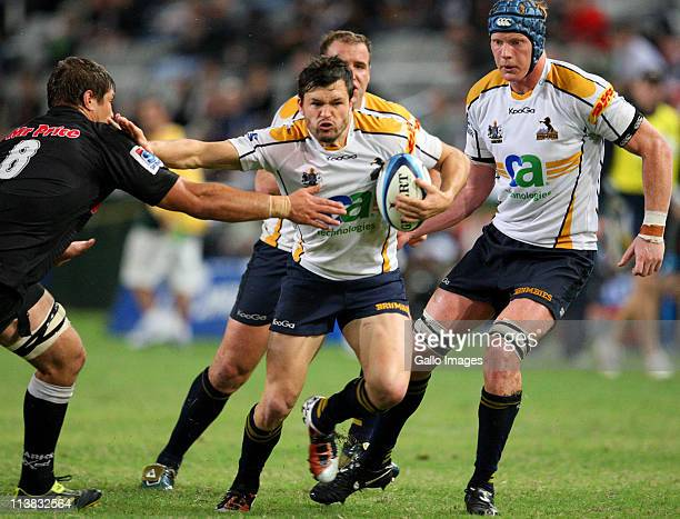 Adam AshleyCooper of Brumbies hands off during the Vodacom SupeRugby match between the Sharks and Brumbies from Mr Price Kings Park on May 07 2011 in...