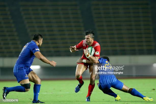 Adam AshleyCooper of Kobelco Steelers is tackled by Garth April of NTT Communications Shining Arcsduring the Rugby Top League match between Kobelco...