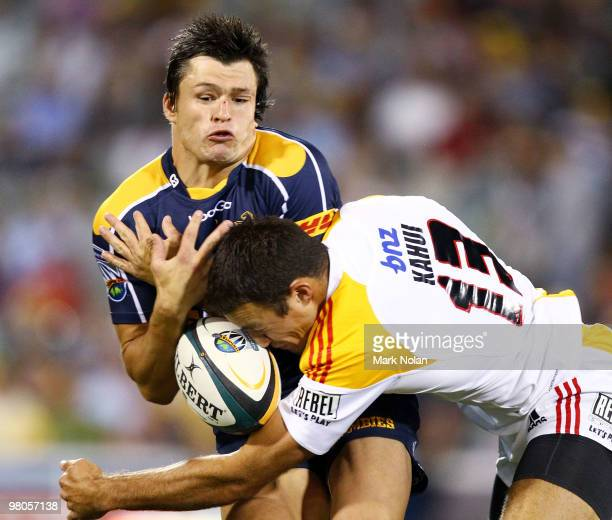 Adam Ashley-Cooper of the Brumbies is tackled by Richard Kahui of the Chiefs during the round seven Super 14 match between the Brumbies and the...