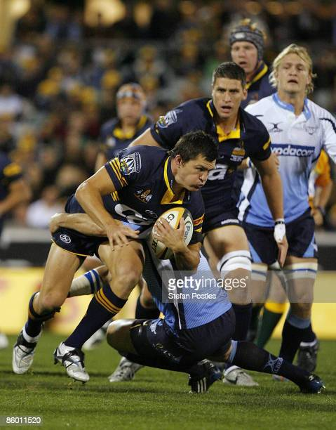 Adam AshleyCooper of the Brumbies is tackled during the round 10 Super 14 match between the Brumbies and the Bulls at Canberra Stadium on April 17...