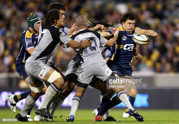 Adam AshleyCooper of the Brumbies runs the ball during the round 10 Super 14 match between the Brumbies and the Hurricanes at Canberra Stadium on...