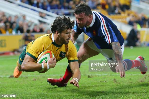 Adam AshleyCooper of the Wallabies dives to score a try during the First International Test Match between the Australian Wallabies and France at...