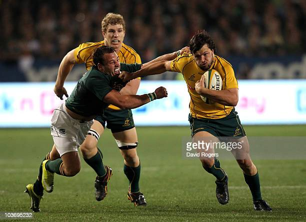 Adam AshleyCooper of the Wallabies holds off Francois Hougaard during the 2010 TriNations match between the South African Springboks and the...