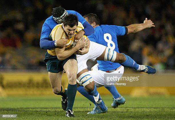 Adam AshleyCooper of the Wallabies is tackled during the Second Test match between the Australian Wallabies and Italy at Etihad Stadium on June 20...