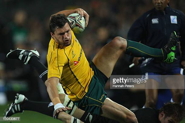 Adam Ashley-Cooper of the Wallabies is taken out during the Tri-Nations Bledisloe Cup match between the New Zealand All Blacks and the Australian...