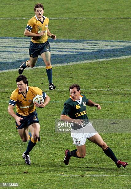 Adam AshleyCooper of the Wallabies makes his national debut during the TriNations Rugby Union match between the Australian Wallabies and the South...
