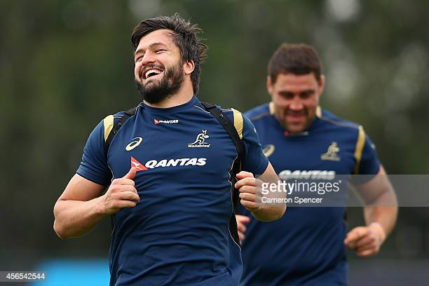 Adam AshleyCooper of the Wallabies smiles during a warmup during an Australian Wallabies training session at Los Tordos RC on October 2 2014 in...