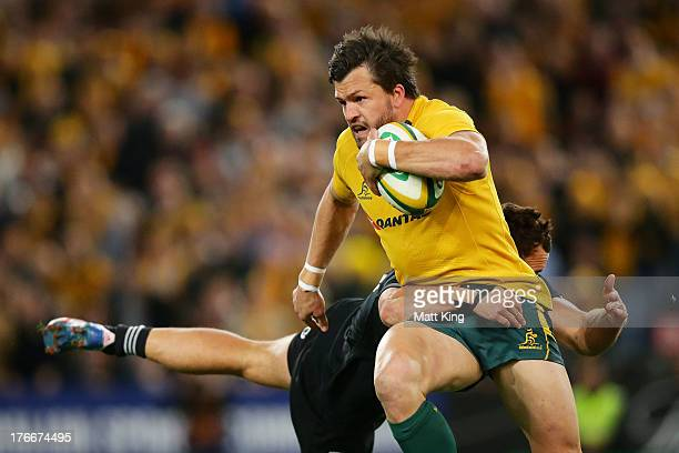 Adam AshleyCooper of the Wallabies tries to break a tackle during The Rugby Championship Bledisloe Cup match between the Australian Wallabies and the...