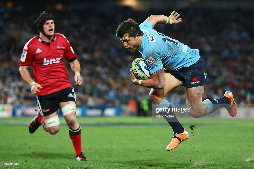 Adam Ashley-Cooper of the Waratahs heads for the try line to score during the Super Rugby Grand Final match between the Waratahs and the Crusaders at ANZ Stadium on August 2, 2014 in Sydney, Australia.