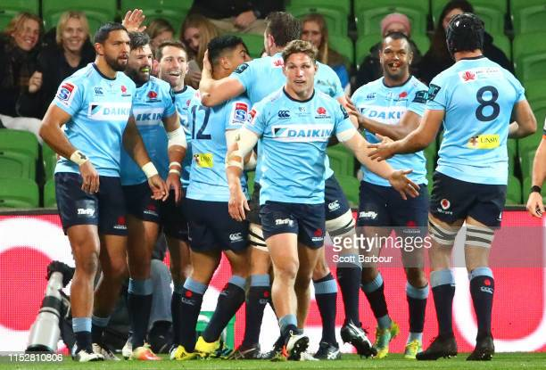 Adam AshleyCooper of the Waratahs is congratulated by his teammates after scoring a try during the round 16 Super Rugby match between the Rebels and...