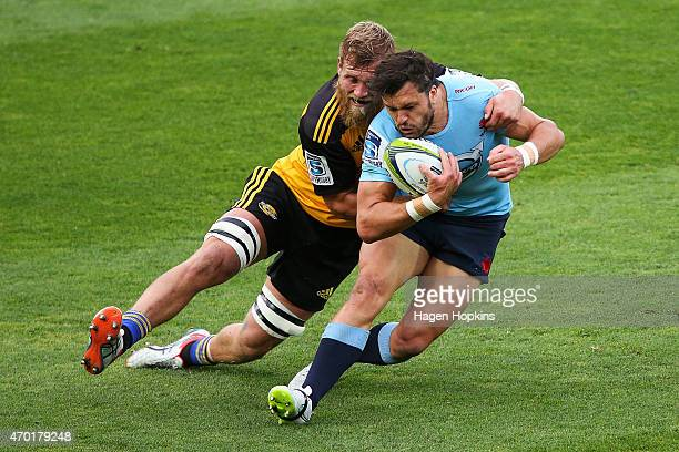 Adam Ashley-Cooper of the Waratahs is tackled by Brad Shields of the Hurricanes during the round 10 Super Rugby match between the Hurricanes and the...