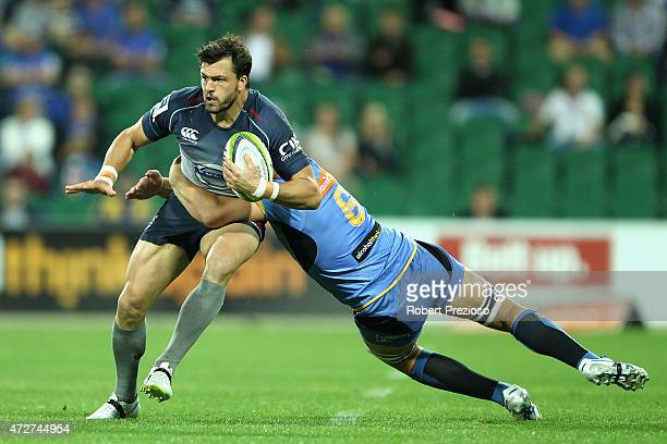 Adam AshleyCooper of the Waratahs is tackled during the round 13 Super Rugby match between the Force and the Waratahs at nib Stadium on May 9 2015 in...