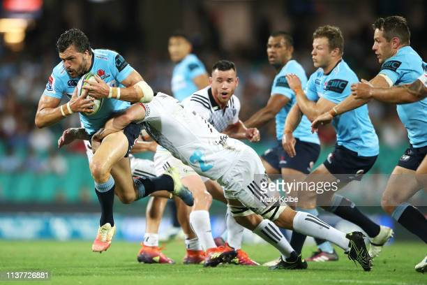 Adam AshleyCooper of the Waratahs is tackled during the round six Super Rugby match between the Waratahs and the Crusaders on March 23 2019 in Sydney...