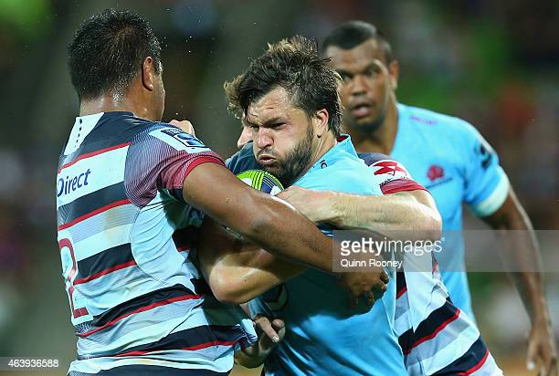 Adam AshleyCooper of the Waratahs is tackled during the round two Super Rugby match between the Rebels and the Waratahs at AAMI Park on February 20...
