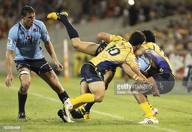 Adam AshleyCooper of the Waratahs is taken out of play during the round four Super Rugby match between the Brumbies and the Waratahs at Canberra...