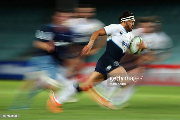 Adam AshleyCooper of the Waratahs runs the ball during the Super Rugby trial match between the Waratahs and the Blues at Allianz Stadium on February...