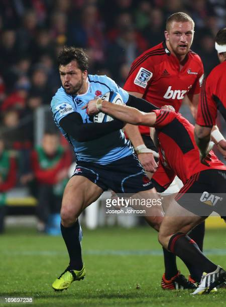 Adam AshleyCooper of the Waratahs runs with the ball during the round 16 Super Rugby match between the Crusaders and the Waratahs at AMI Stadium on...