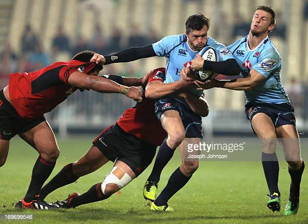 Adam AshleyCooper of the Waratahs runs with the ball with assistance from team mate Rob Horne during the round 16 Super Rugby match between the...