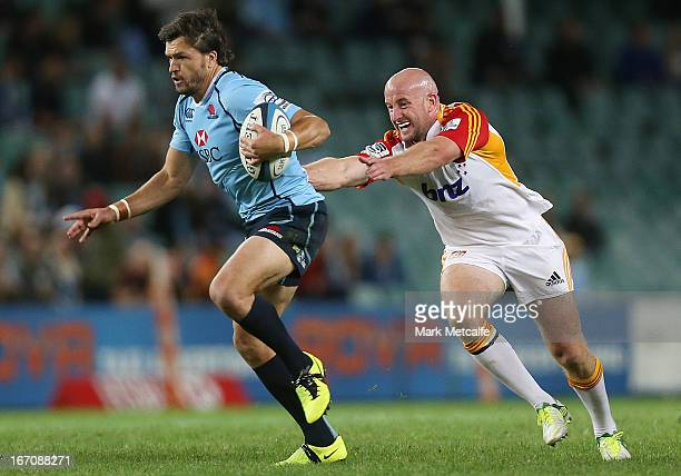 Adam AshleyCooper of the Waratahs takes on Brendon Leonard of the Chiefs during the round 10 Super Rugby match between the Waratahs and the Chiefs at...