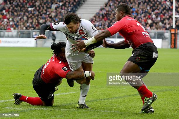 Adam AshleyCooper of Union Bordeaux Begles is tackled by Mathieu Bastareaud and Josua Tuisova of RC Toulon during the Top 14 rugby match between...
