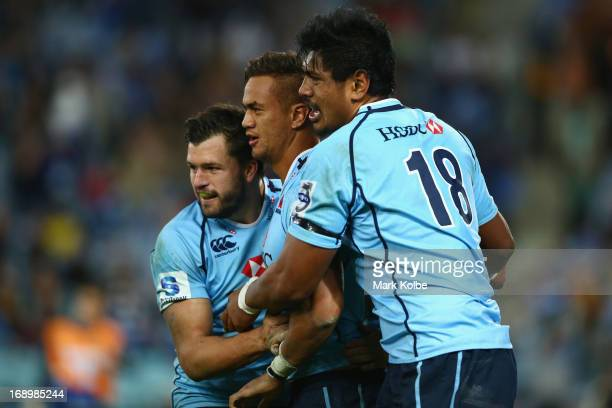 Adam AshleyCooper Peter Betham and Will Skelton of the Waratahs celebrate after Betham scored a try during the round 14 Super Rugby match between the...