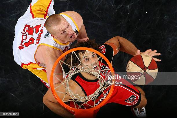 Adam Ballinger of the Tigers and Mattthew Knight of the Wildcats contest a rebound during the round 20 NBL match between the Perth Wildcats and the...